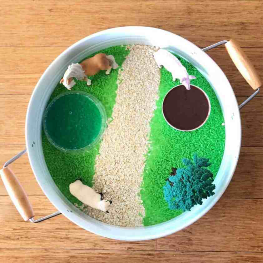 how to setup a farm sensory bin adding the farm animals