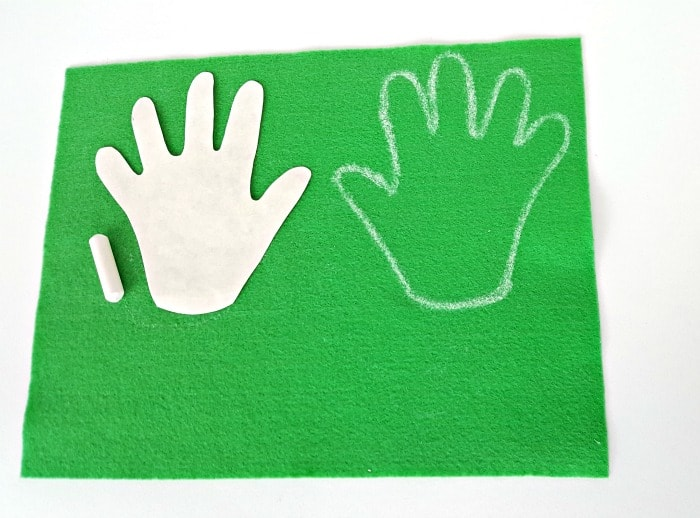 trace hands onto felt with chalk or marker toddler handprint flower craft fine motor activity