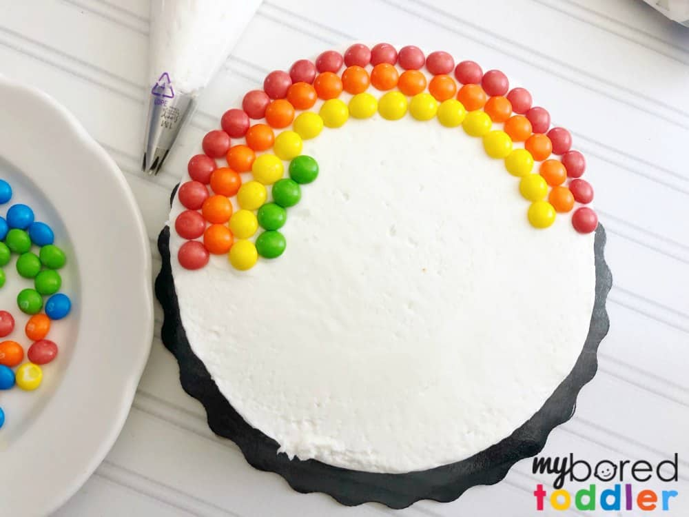 how to make an easy rainbow birthday cake with skittles and marshmallow step 3