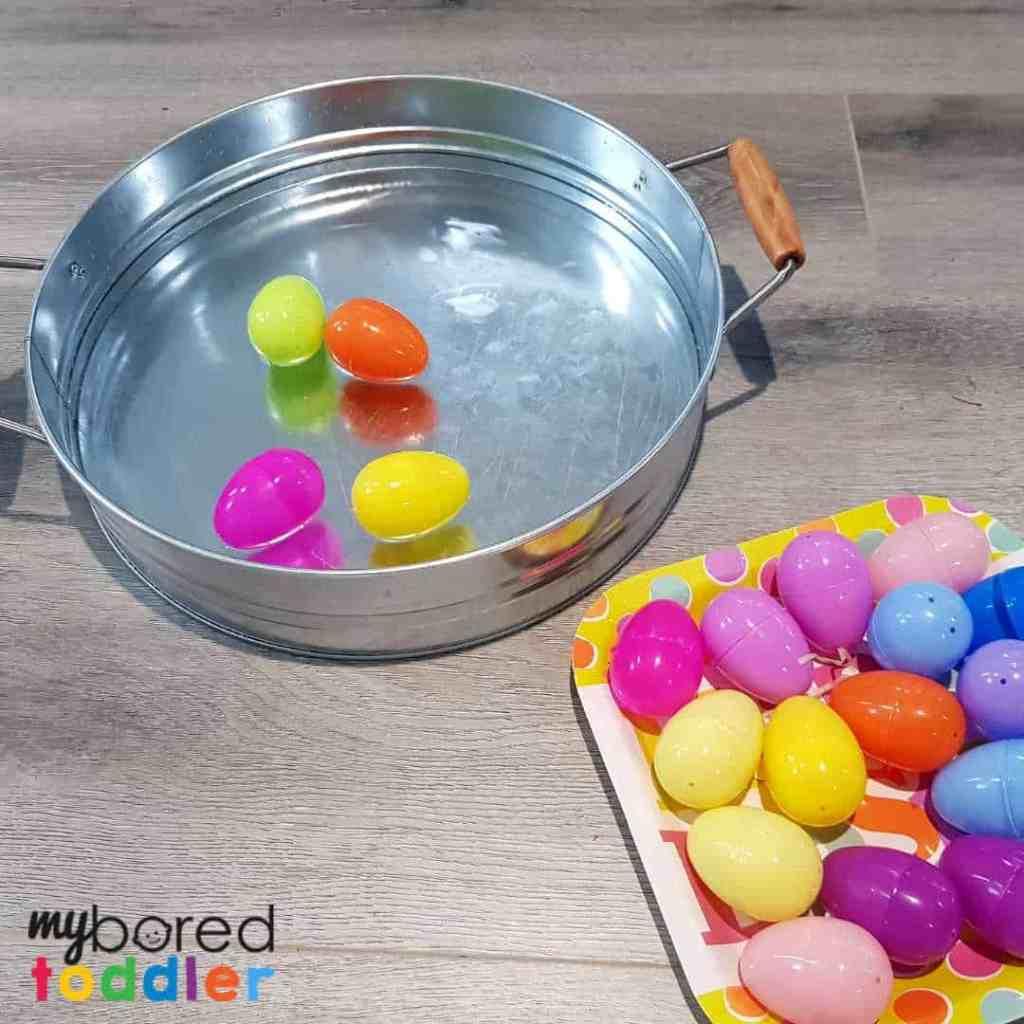 plastic easter egg water scooping sensory bin 2