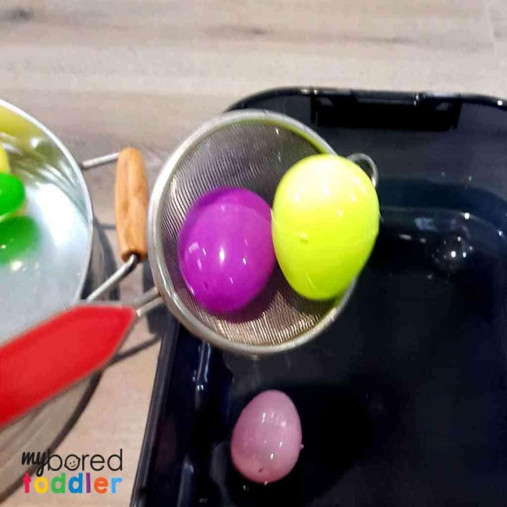 plastic easter egg water scooping sensory bin 5