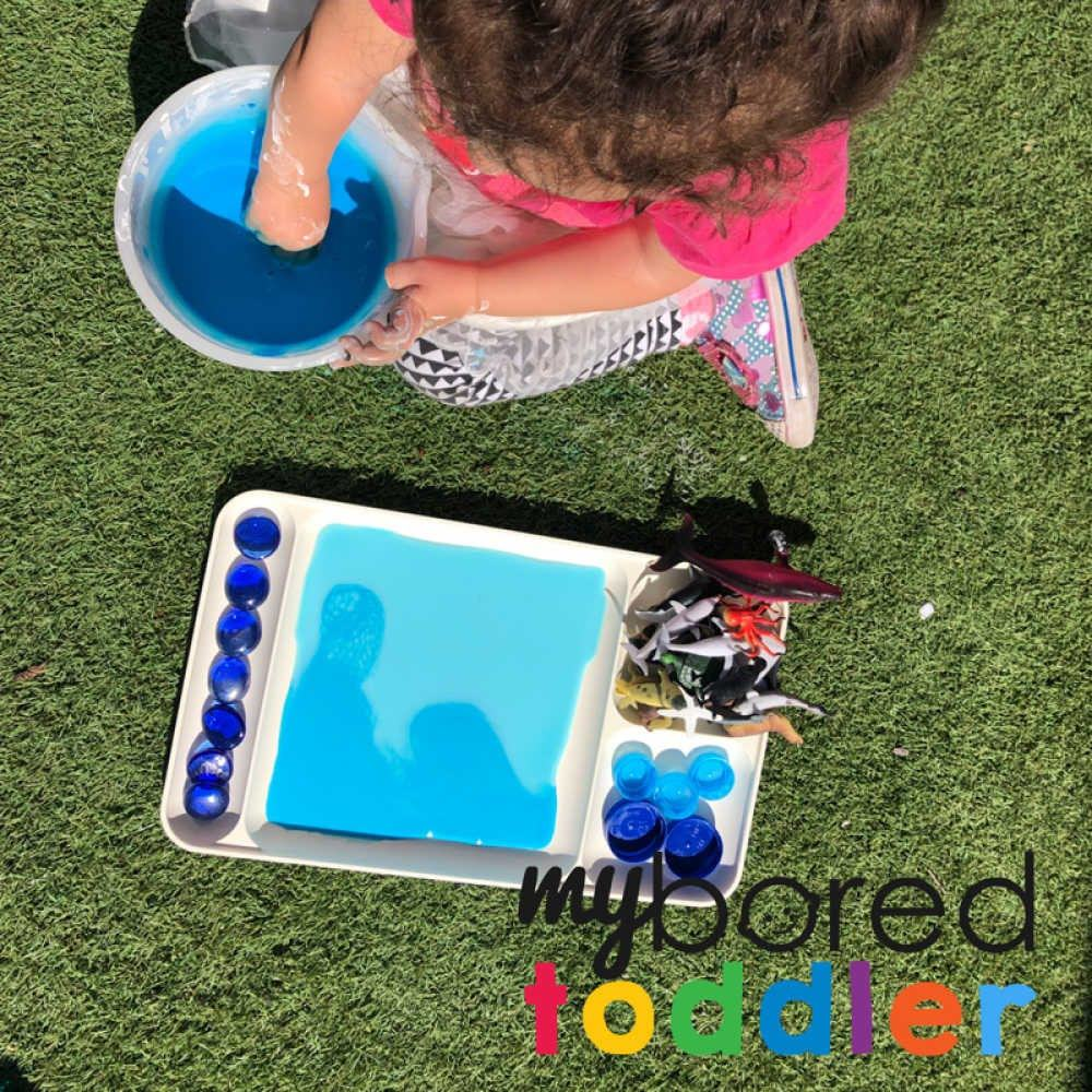 playing with color gradient oobleck - messy play for toddlers to do at home