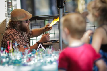 little boy watching artist at Saturday Market in downtown Portland