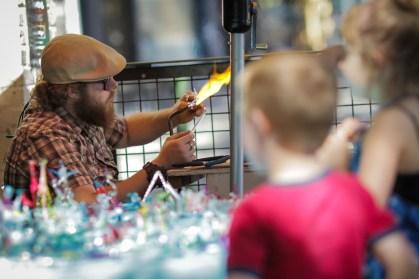 little boy watching artist at Saturday Market in downtown Portland