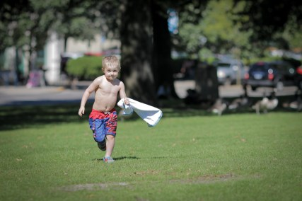 little boy running with towel in portland, Oregon