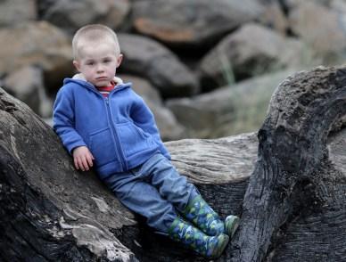 little moody boy in blue sweatshirt