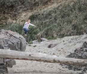 little boy flying through the air