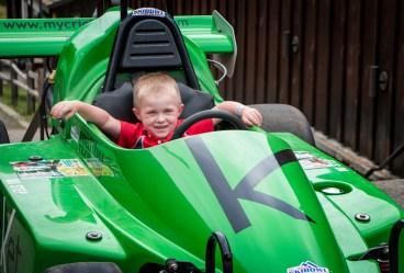 Evan in green race car