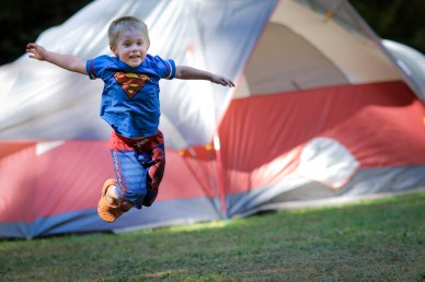 evan jumping by tent