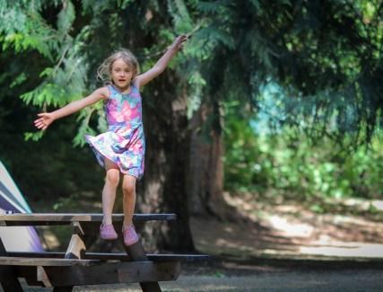 little girl jumping