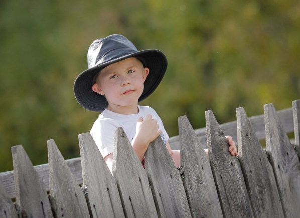 little boy in black leather hat