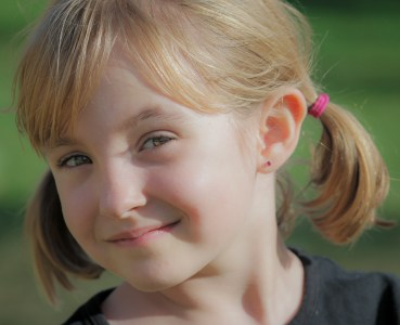 smiling girl with pigtails