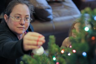 Mom decorating Christmas tree