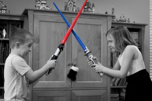 brother and sister light saber fight