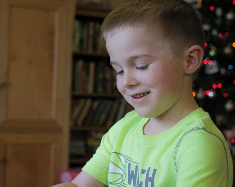 little boy profile smiling