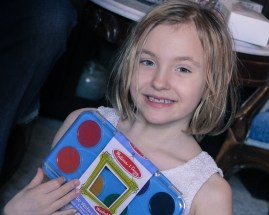 little girl happy with her Christmas presents