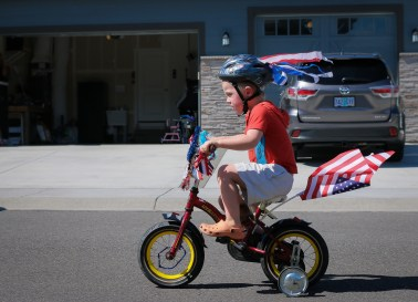 little boy riding patriotic bike