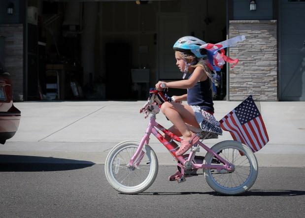 little girl riding patriotic bike