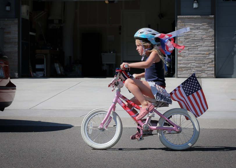 little girl riding patriotic bike