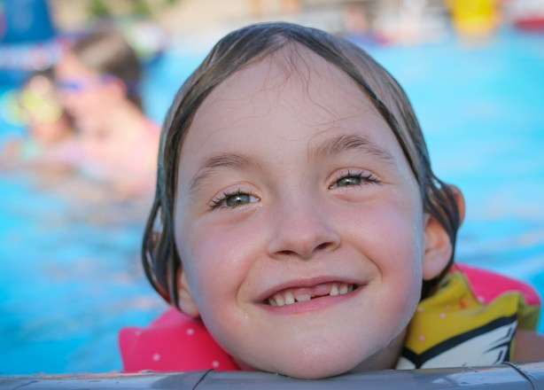 smiling little girl swimming