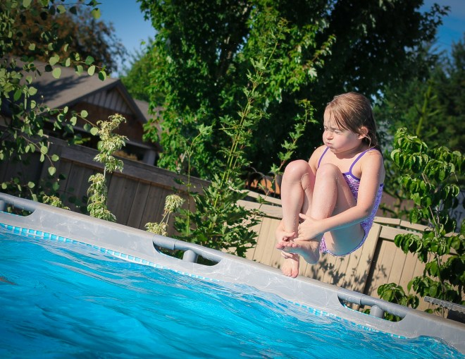 little girl cannonball into pool