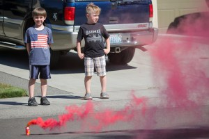 little boy watching smoke bomb
