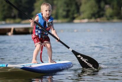 little boy on paddle board