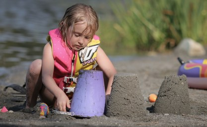 little girl playing with sand toys