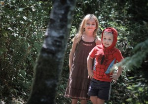 brother and sister in woods