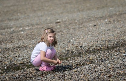 little girl by water's edge
