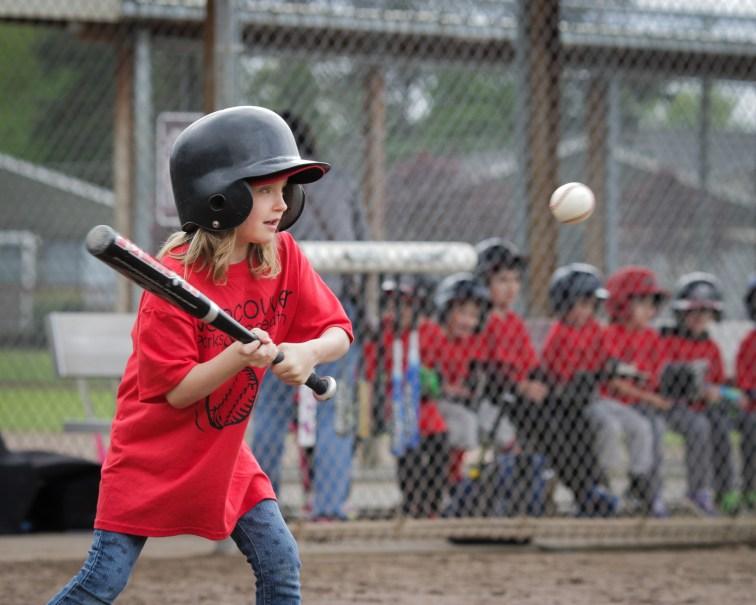 little girl batting