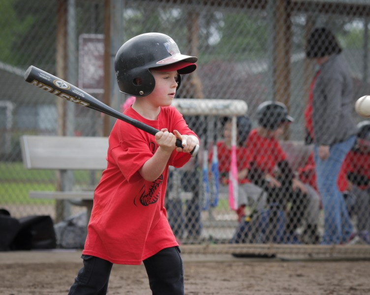 little boy batting