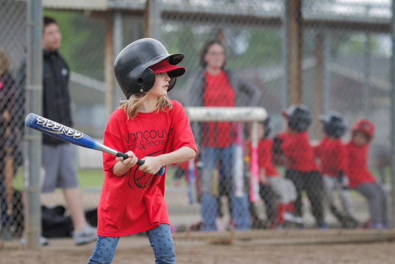 little girl hitting baseball