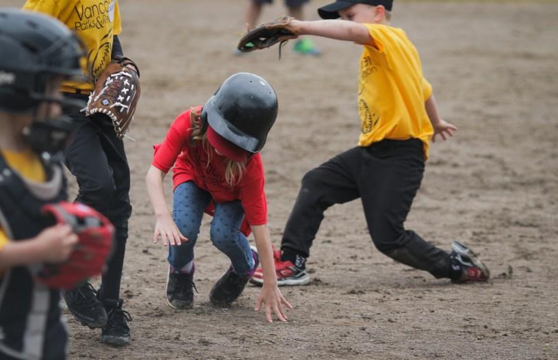 girl falling baseball