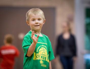 evan waving on basketball court