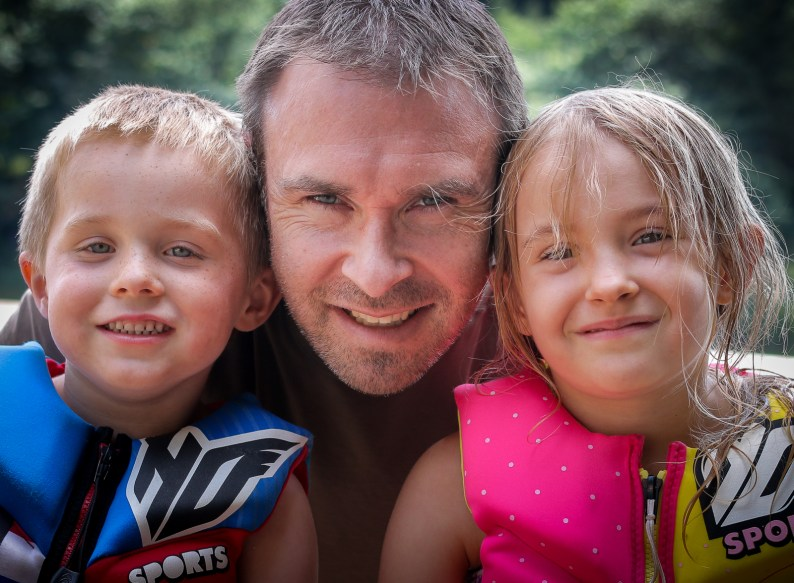Dad with son and daughter in life jackets