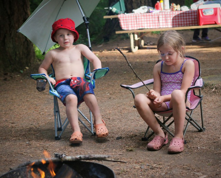 little kids in chairs camping
