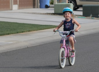 little girl riding bike