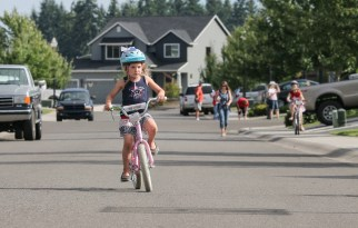 little girl concentrating riding bike