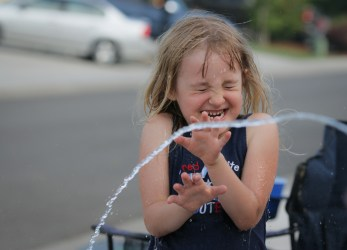 little girl getting squirted