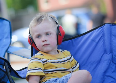 little boy with ear protection