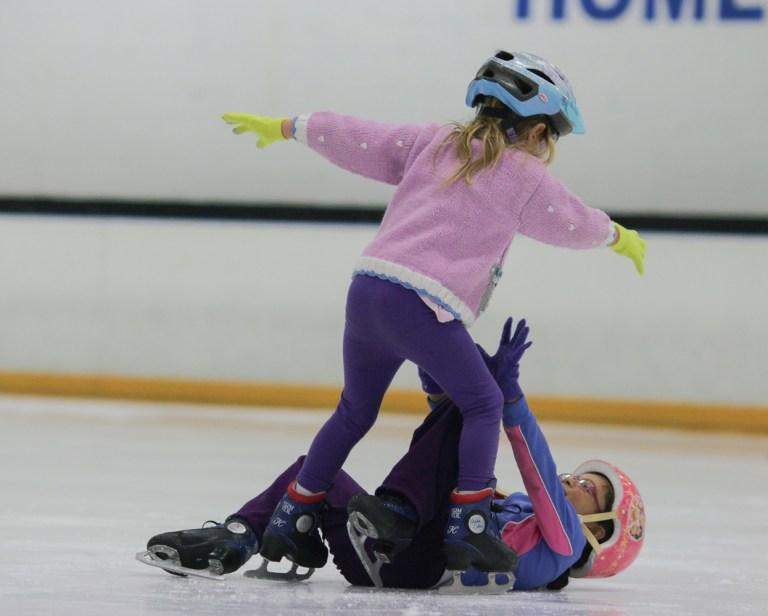 girl ice skating falling down