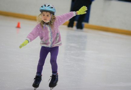 little girl ice skating lessons