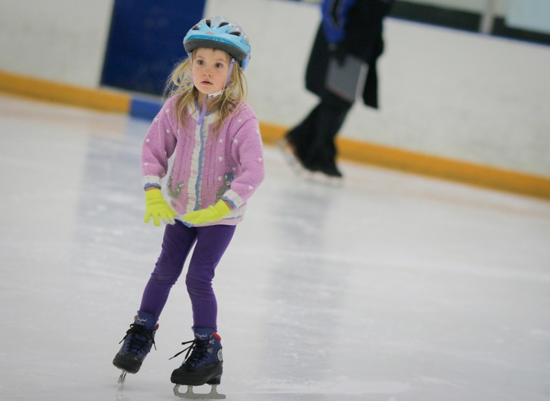 little girl new to ice skating
