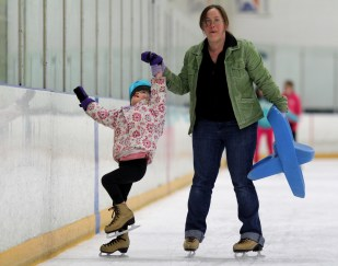 mom daughter ice skating girl falling