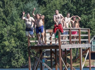 men jumping into water simultaneously