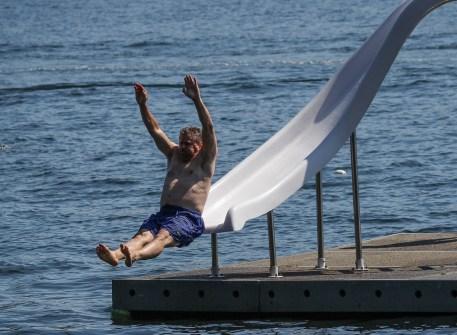 man flying off of water slide