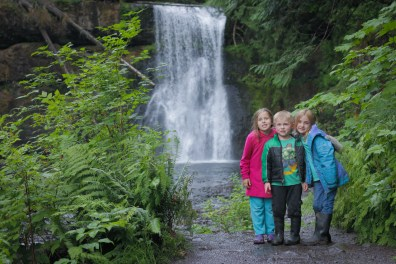 three kids posing under silver falls