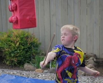 boy whacking pinata
