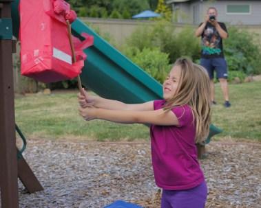 girl hitting pinata